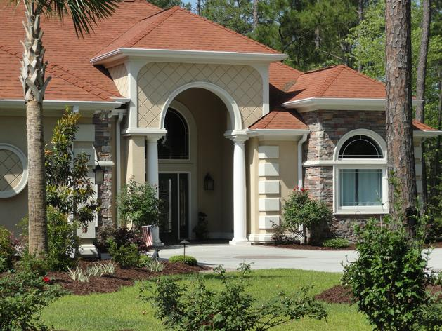 Image of Charles M. Schwab. This beautiful accessible home shows a no step front entry of a home he designed in Myrtle Beach